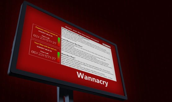 A computer screen displaying the WannaCry ransomware note