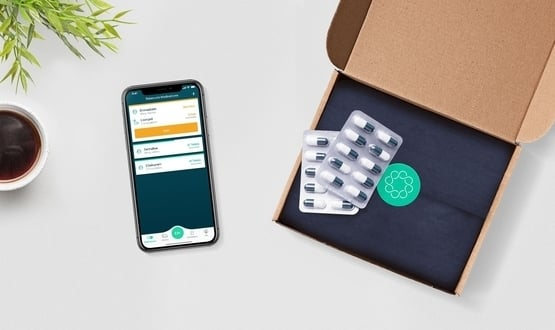 A smartphone displaying the Echo app next to a box of medication