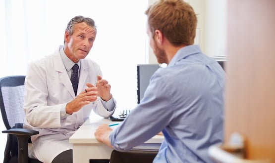 A doctors speaks with a patient in a GP pratice