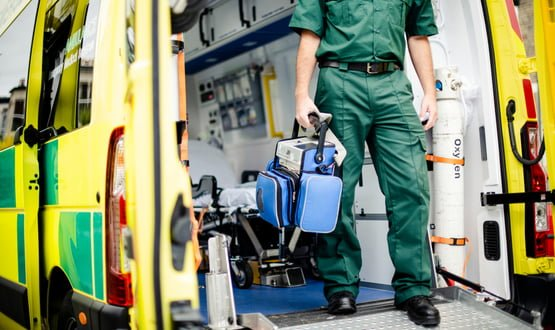 A paramedic stepping out of an ambulance