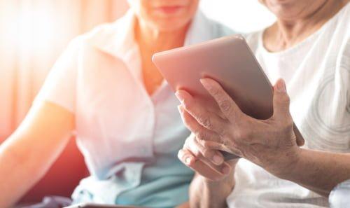Elderly couple using technology