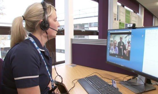 A nurse at Airedale NHS Foundation Trust speaking to a care home resident via Immedicare's telemedicine service