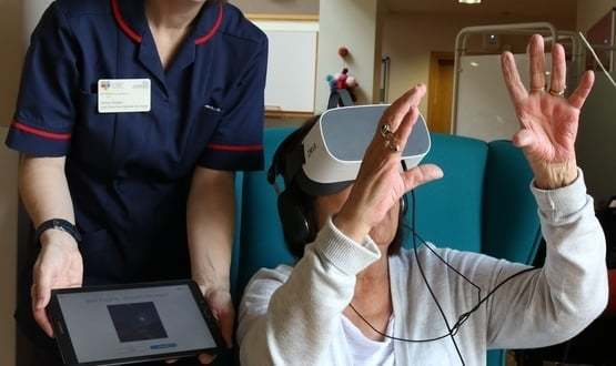 Meadow House patient Joy Pilgrim uses a virtual reality headset
