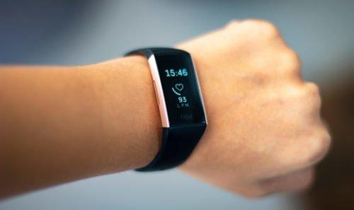 Person wearing FitBit smartwatch