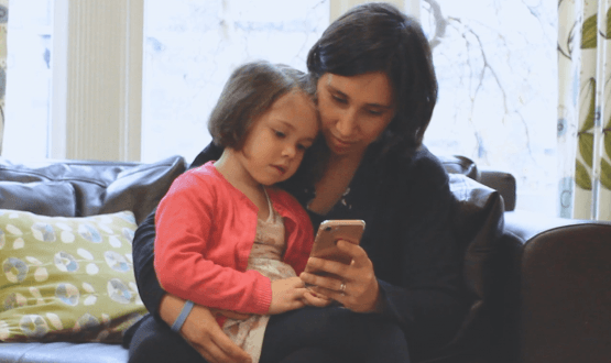 A mother and daughter explore the Little Journey app