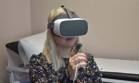 A woman using a virtual reality headset used by North Lincolnshire COPD patients